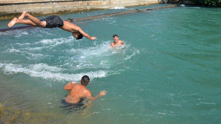 Termometrelerin 46 dereceyi gösterdiği Adana'da tehlikeli serinlik