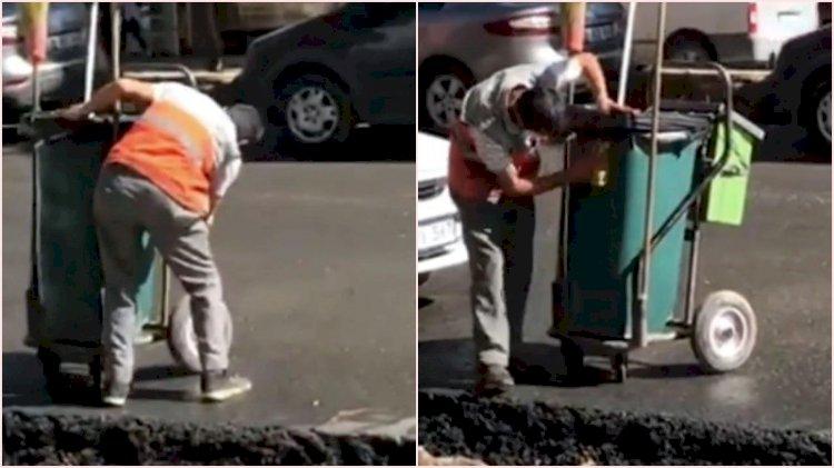 El arabasını silerken görüntülenen temizlik işçisi ödüllendirildi