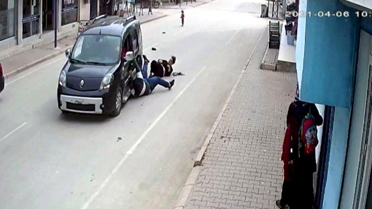 Telefonunu gasbettiği genç kız ile kardeşini aracıyla metrelerce sürükledi