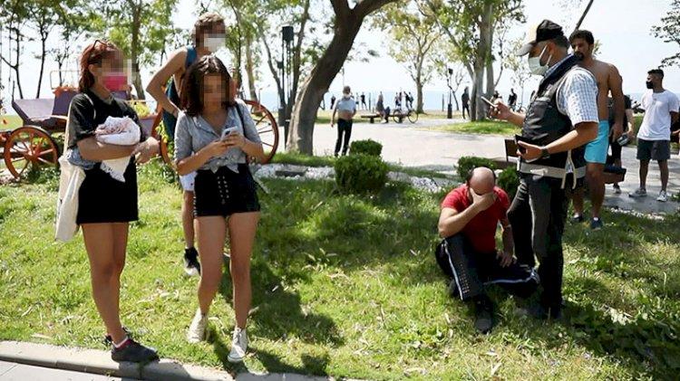 Genç kızların dikkati plajdaki sapığı yakalattı