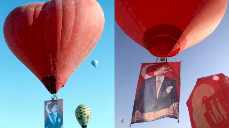 Kapadokya'da sıcak hava balonları Atatürk posteri ve bayrakla havalandı